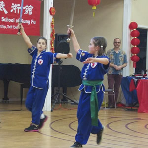 Cordelia and Amadine perform at a 10,000 Victories Northern Shaolin and Tai Chi Show