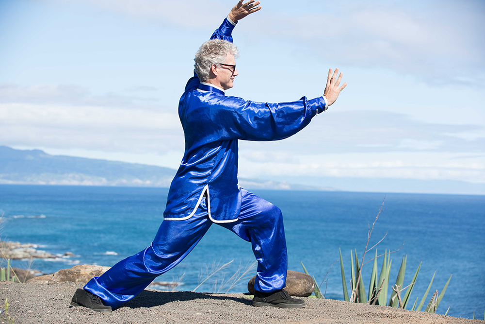 Scott Jensen practices Tai Chi Chuan in Maui while pressing his feet flat and gripping the ground to improve balance and Qi.