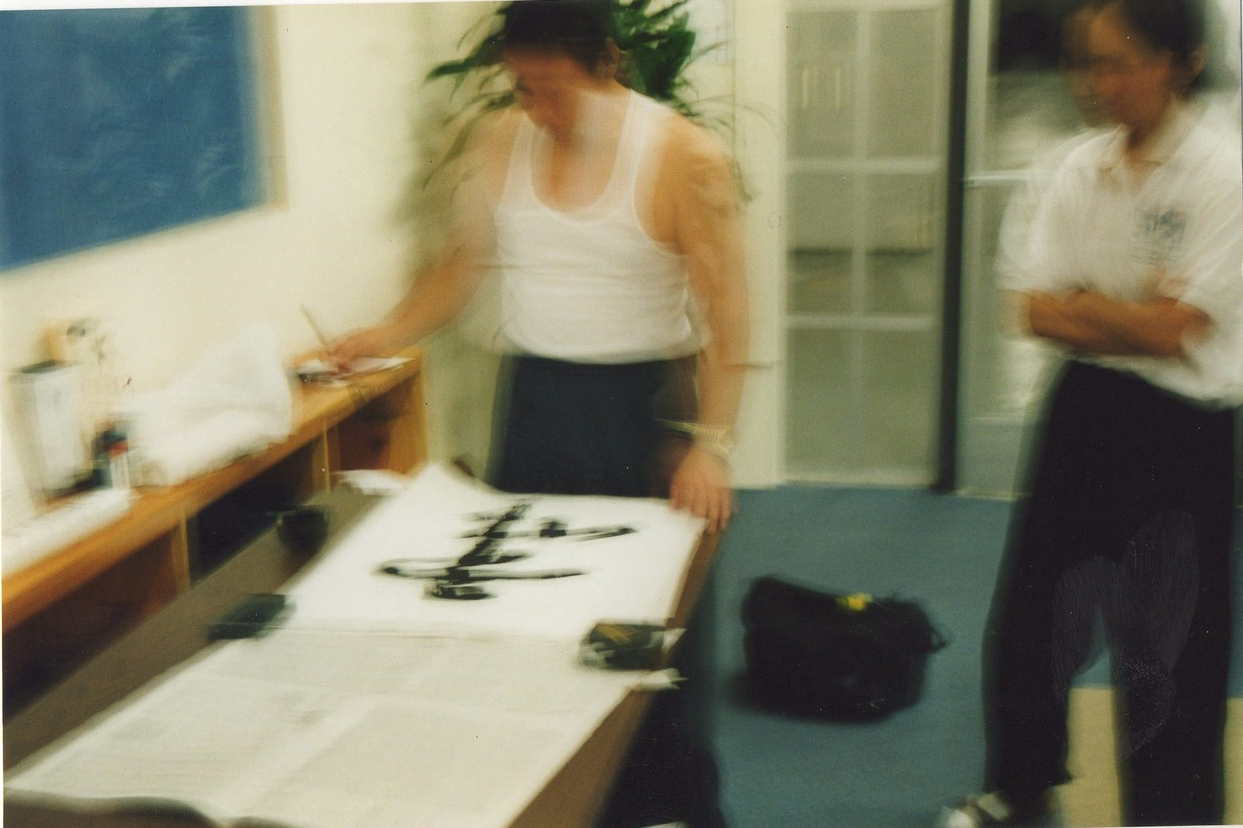 Chen Xiao Wang writes Chinese Calligraphy for Scott Jensen 1999