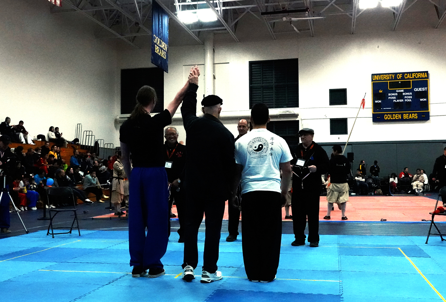 Judge Robert Alexander raises Henry Geddes hand to signal his victory in his match in Tai Chi Push Hands division.